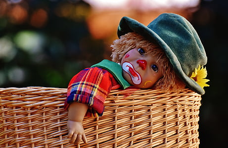 baby clown doll on basket