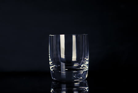 selective focus photography of clear drinking glass