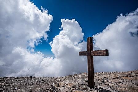 brown wooden cross taken at daytime