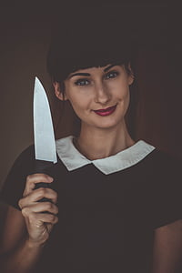 smiling woman holding knife