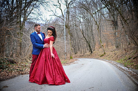 wedding couple standing on concrete road