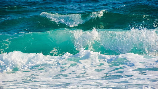 photo of beach waves during daytime
