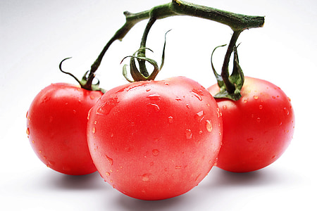 close-up photo of red tomato