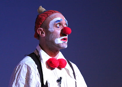 person wearing red Pierrot nose