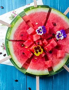 slice watermelon with yellow petal flower