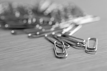 shallow focus photograph of gray paper clip lot