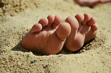 feet under the sand