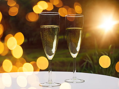 two clear wine glasses on top of table in shallow focus photography