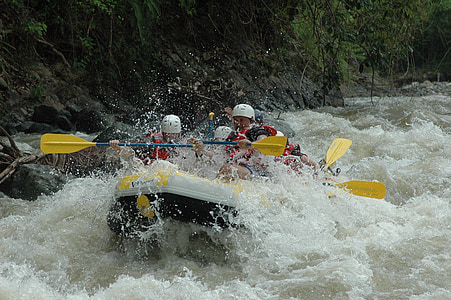 group of people water rafting on waves