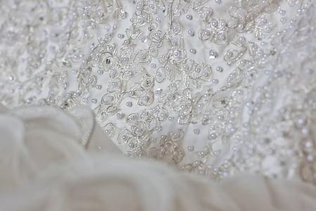 beaded white textile
