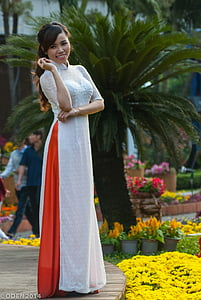 woman standing near sago palm plant