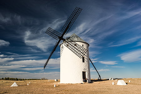 white and black windmill on desert