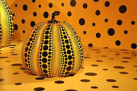 yellow and black ceramic gourd figurine