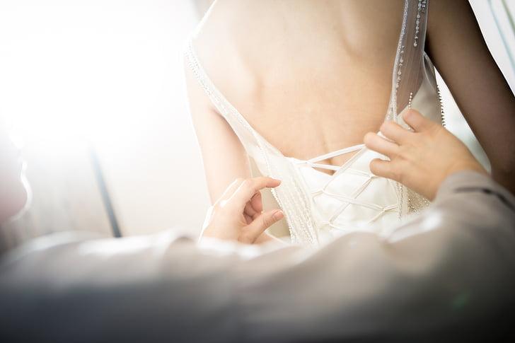 woman in white sleeveless wedding dress