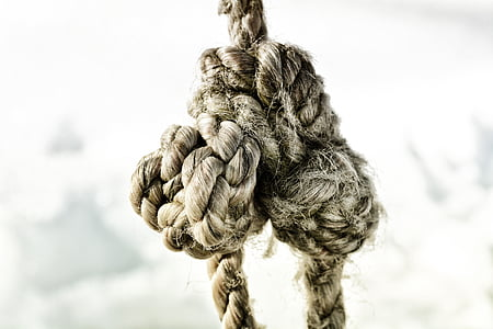 tied brown rope grayscale photo