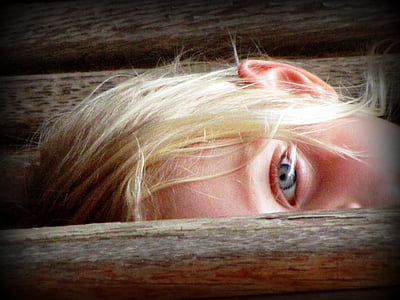 girl with blonde hair showing her eye