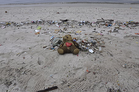 gray teddy bear on gray sand