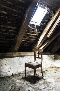 brown wooden chair under skylight