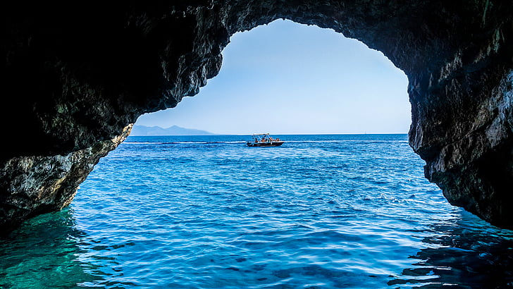 natural arch over ocean water