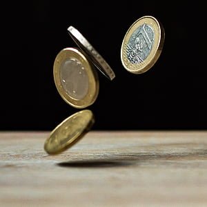 closeup photography of falling coins