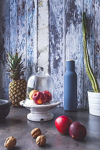 fruits and walnuts placed on beige shelf