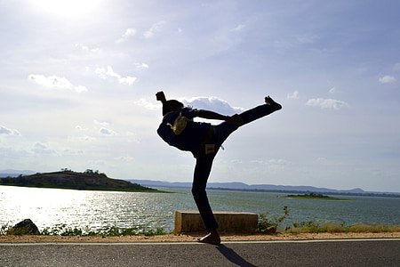 silhouette photo of man near water during daytime