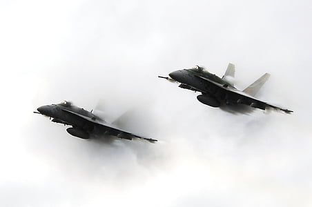 two flying fighter jets