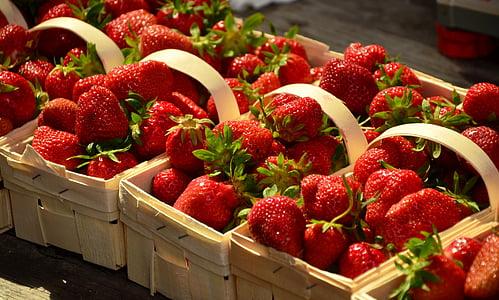 several basket of strawberry fruits