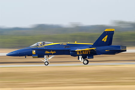 blue and yellow jet plane on brown asphalt during daytime