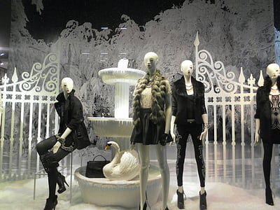 woman mannequin beside white swan decoration