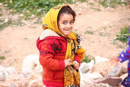 boy smiling wearing red jacket
