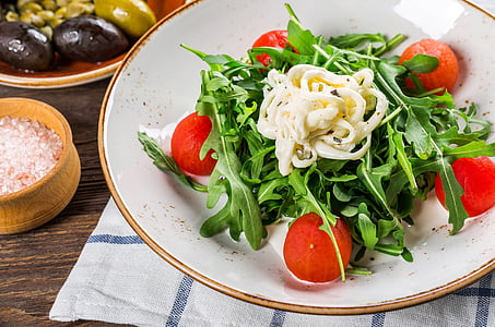 vegetable salad with cream on white ceramic plate