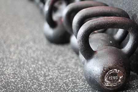 close-up photo of black kettle bells