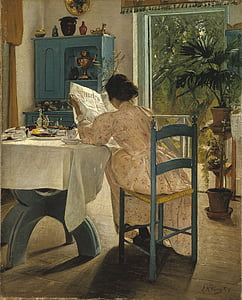 woman sitting on chair beside table