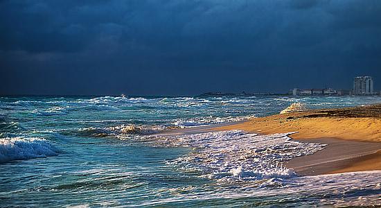 photo of ocean under blue cloudy sky