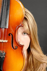 woman behind violin looking straight