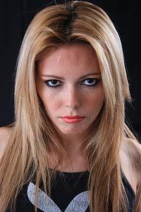 woman in blonde hair wearing black Playboy top