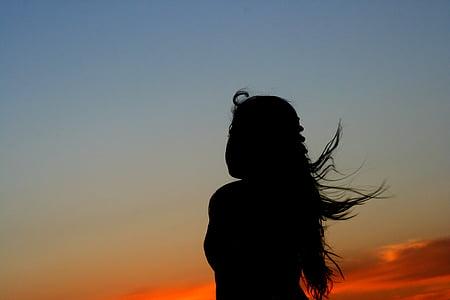woman staring at sky