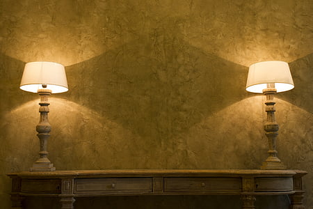 two brown-and-white table lamps turned on