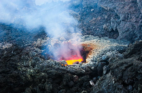 volcano lava surrounded with rock during daytime