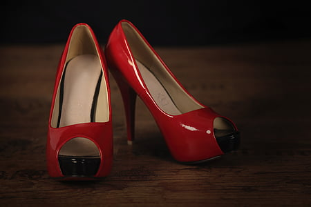 pair of women's red pumps