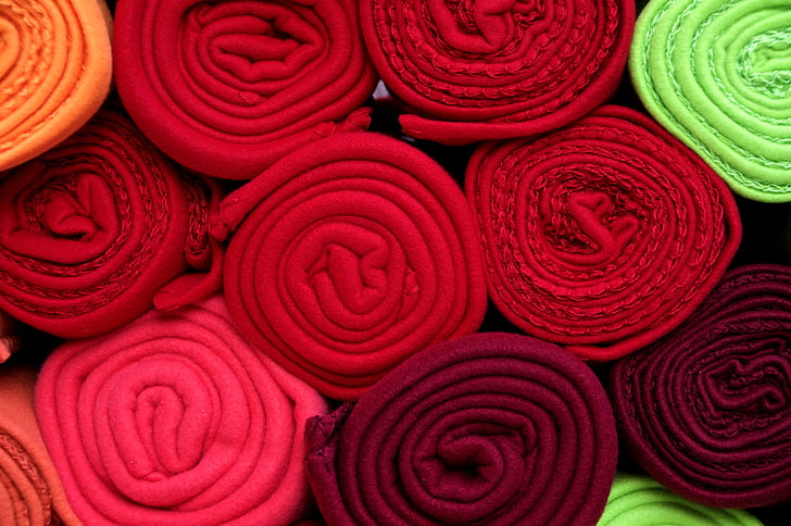 pile of assorted-color textile rolls
