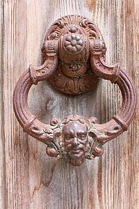 brown steel door knocker