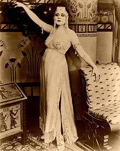 woman posing near chair