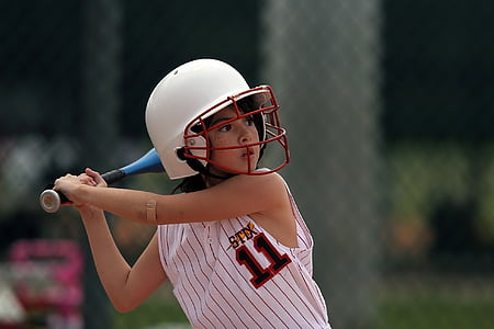 close-up photography of girl holding baseball bat