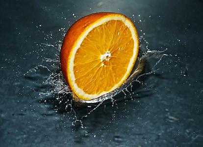 sliced orange citrus fruit on water
