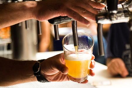 timelapse photography of man pressing the beverage dispenser