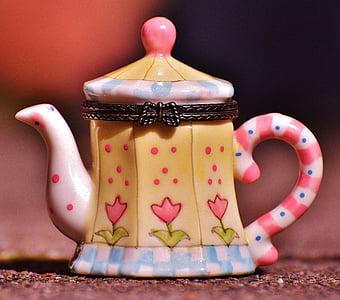 beige and white ceramic teapot container