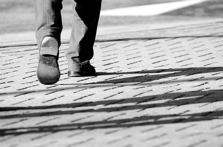 Royalty Free photo: Person wearing pair of black shoes while