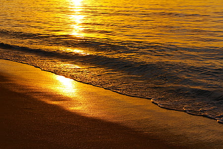 photo of sea waves during golden hour